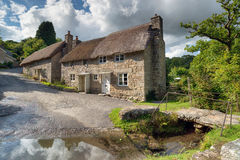 Ponsworthy on Dartmoor. Beautiful thatched cottages beside a ford at Ponsworthy on Dartmoor National Park in Devon Royalty Free Stock Image