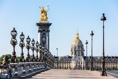 Pont Alexandre III Bridge with Hotel des Invalides. Paris, France royalty free stock image