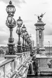 Pont Alexandre III bridge Paris. In black and white with row of street lamps Stock Image