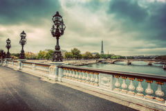 Pont Alexandre III bridge in Paris, France. Seine river and Eiffel Tower. Vintage Stock Photo