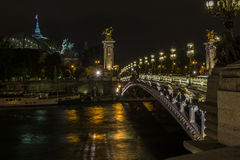 Pont Alexandre III e grande Palais alla notte Fotografie Stock