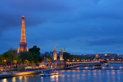 Pont Alexandre III and Eiffel tower in Paris Stock Photos