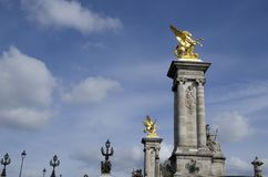 Statues of Pont Alexandre III. Pont Alexandre III is largely regarded as the most beautiful bridge in the city. It has many beautiful artworks such as statues Royalty Free Stock Images