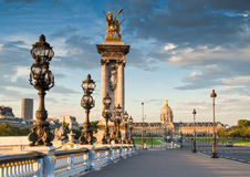 Pont Alexandre III, Paris, France. Stunning Pont Alexandre III bridge (1896) spanning the river Seine. Decorated with ornate Art Nouveau lamps and sculptures it Royalty Free Stock Images
