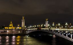 Pont Alexandre III and Invalid at night - Paris, France royalty free stock image
