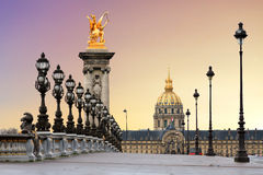 Pont Alexandre III sunrise. Beautiful sunrise at the Pont Alexandre III and Les Invalides in Paris Stock Image