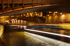 Bridge and Seine river at night, Paris Stock Photography