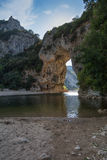 The Pont d'Arc is a large natural bridge. The Pont d'Arc is a large natural bridge, located in the Ardèche département in the south of Franc. The arch, carved Royalty Free Stock Photography