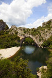 Pont d'arc leisure. People canoeing and swimming below Pont d'Arc, the natural rock arch across Ardèche river Stock Photos