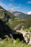 Pont d'Asfeld, France. Old stone bridge in the French Alps Stock Image