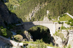 Pont d'Asfeld, France. Old stone bridge in the French Alps stock photo