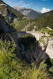 Pont d'Asfeld, France. Old stone bridge in the French Alps stock images