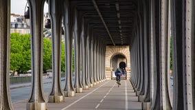 Pont de Bir-Hakeim. PARIS, FRANCE - JUNE 13, 2017: Cyclist riding on pont de Bir-Hakeim bridge - a bridge that crosses the Seine River stock footage