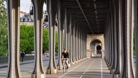 Pont de Bir-Hakeim. PARIS, FRANCE - JUNE 13, 2017: Cyclist riding on pont de Bir-Hakeim bridge - a bridge that crosses the Seine River stock video