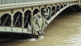 Floodings in Paris, France. Pont de Bir-Hakeim and swollen river Seine embankments overflow flooding in Paris - news footage - statues in water stock video footage