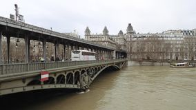 Pont de Bir-Hakeim and swollen river Seine embankments overflow flooding in Paris. PARIS, FRANCE - JAN 30, 2018: Pont de Bir-Hakeim and swollen river Seine stock video footage