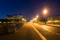 Pont de la Tournelle. Bridge at night in Paris, France Royalty Free Stock Photo