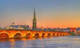 Pont de Pierre bridge and Saint Michel Basilica in Bordeaux, France royalty free stock photos