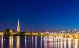 Pont de Pierre bridge and Saint Michel Basilica in Bordeaux, France royalty free stock photo
