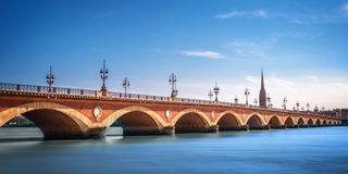 Pont de Pierre bridge with St Michel cathedral, Bordeaux, France Stock Photography