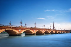 Pont de Pierre bridge with St Michel cathedral, Bordeaux, France stock photos