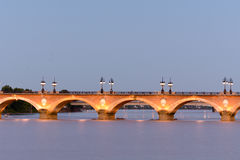 Pont de Pierre bridge at sunset Bordeaux, France Stock Photography