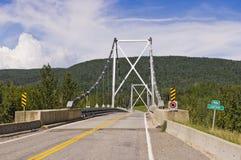 Pont de rivière de Liard Image stock