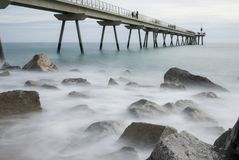 Pont del Petroli, Badalona, Spain. A place for walking over the sea Royalty Free Stock Photo