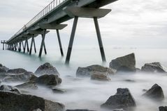 Pont del Petroli, Badalona, Spain. A place for walking over the sea Stock Photos