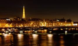 Pont des Arts в Париже на ноче Стоковые Изображения