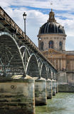 Pont des Arts. Institut de France and the Pont des Arts or Passerelle des Arts bridge across river Seine in Paris, France stock image