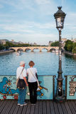 Pont des Arts bridge in Paris. Senior couple looking at the river Seine from Pont des Arts bridge, Paris, France Royalty Free Stock Image