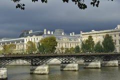 Pont des Arts and Louvre, Paris. The famous Louvre behind the Pont (=bridge) of Arts, Paris, France Royalty Free Stock Photos