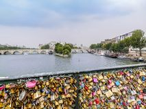 Pont des arts. With many love padlocks attached to the bridge fence, Paris, France Stock Photos