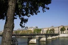 Pont des arts in Paris. Pont des arts or passerelle des arts in Paris which crosses the Seine River with the Palais du Louvre in the background Stock Photo