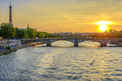 Pont des Invalides and Eiffel tower at sunset Stock Images