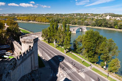 Pont du Avignon and city walls tower beside street and Rhone riv Stock Image