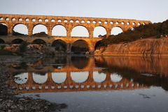Pont du gard. At sunrise.  The  is the major stonework of a 50km aqueduct that runs between Uzès and Nîmes in the South of France. It is located in Vers-Pont Royalty Free Stock Photo