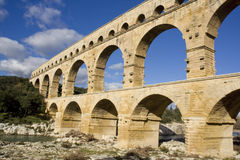 Pont du gard. The Pont du Gard was built shortly before the Christian era to allow the aqueduct of Nîmes (which is almost 50 km long) to cross the Gard river Stock Image