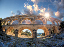 Pont du Gard against sunset is an old Roman aqueduct in Provence, France Stock Photo