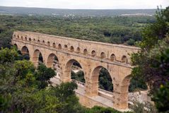 Pont du Gard aqueduct. A partial view of the Pont du Gard aqueduct built by the Romans in southern France Stock Photos