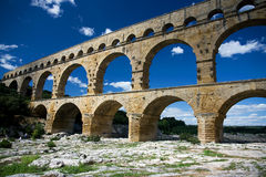 Pont du Gard Aqueduct. The Pont du Gard, an ancient Roman aqueduct bridge that crosses the Gard River in southern France Stock Image