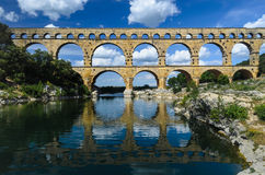 Pont du Gard and Blue Cloudy Skies. Beautiful photograph of the near 2000 year old Roman aqueduct near Uzes, Provence. One of the best preserved aqueducts in the stock photo