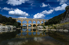 Pont du Gard and Blue Cloudy Skies. Beautiful photograph of the near 2000 year old Roman aqueduct near Uzes, Provence. One of the best preserved aqueducts in the royalty free stock image
