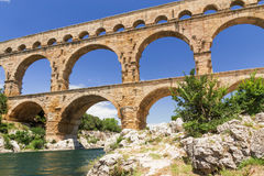 The Pont du Gard in France. The Pont du Gard is an ancient Roman aqueduct that crosses the Gardon River in South France. Horizontally Stock Photo