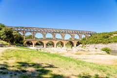 Pont du Gard, France. The picturesque landscape with ancient aqueduct on the list of UNESCO Stock Image