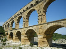 Pont Du Gard in France, World Heritage Site. The ancient Roman aqueduct bridge Pont Du Gard, crossing the Gard river in southern France. Part of the UNESCO List Royalty Free Stock Image