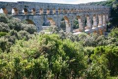 Pont du Gard through Gardon River in France Royalty Free Stock Photos