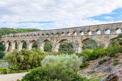 Pont du Gard, an old Roman aqueduct near Nimes in Southern Franc. Pont du Gard is an old Roman aqueduct near Nimes in Southern France. Travel destination for Royalty Free Stock Photo