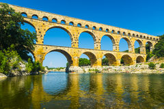 Pont du Gard. Is an old Roman aqueduct, southern France near Avignon. Reflection in the river Gard Stock Photos